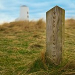 Llanddwyn lighthouse and wooden post